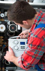 hvac technician servicing an oil fired boiler